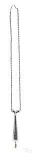 Platinum and onyx diamond pendant