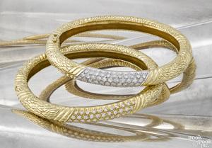 Pair of 18K yellow gold and diamond bracelets