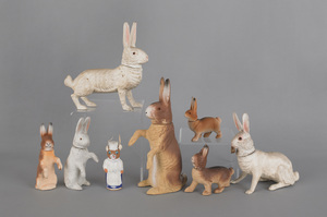 Eight composition rabbit candy containers, late 19