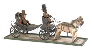 American carving of Abraham Lincoln in a horse dra
