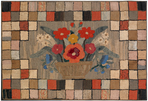 Large American hooked rug, 19th c., with a basketf