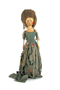 English Queen Anne wooden doll, with brown glass e