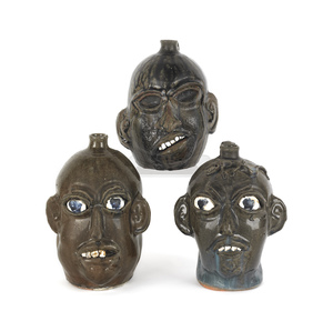 Three Georgia stoneware face jugs by Chester Hewel