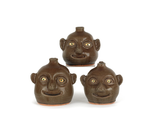 Three Georgia stoneware face jugs by Reggie Meader