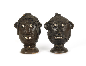 Two Georgia stoneware face jugs by Flossie Meaders