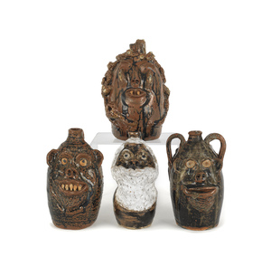 Four Georgia stoneware face jugs by Marie Rogers,l