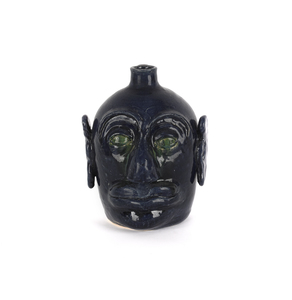 Georgia stoneware face jug by Edwin Meaders, signe