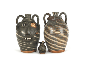 Two North Carolina stoneware jugs, together with a