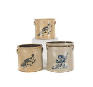 Three stoneware crocks, 19th c., with cobalt birdn