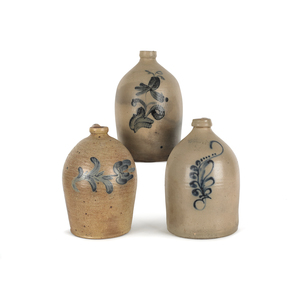 Three American stoneware jugs, 19th c., with cobal