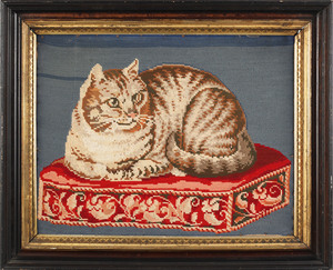 Victorian pictorial needlework of a cat resting on