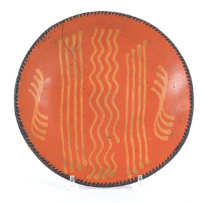 Pennsylvania redware charger, 19th c., with yellow