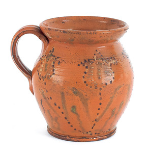 Pennsylvania redware pitcher, 19th c., with spotte