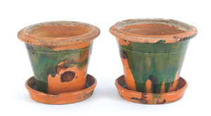 Pair of Pennsylvania redware flower pots, possibly