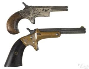Two spur trigger single shot pistols