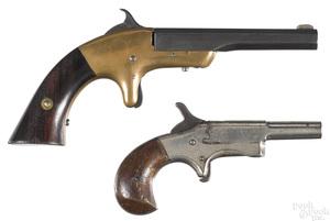 Two side swing spur trigger single shot pistols