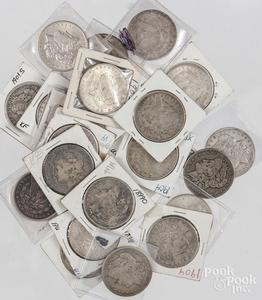 Twenty-two Morgan silver dollars.