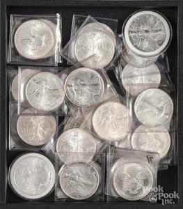 Twenty-two Walking Liberty silver dollars.