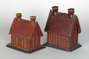 Two chip carved painted house banks