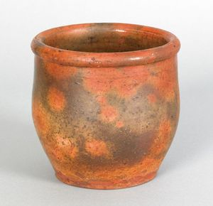 Pennsylvania redware crock, 19th c., with green ox