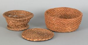 Two rye straw baskets, 19th c., one with a footedi