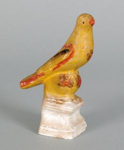 Chalkware song bird on perch, 19th c., retaining a