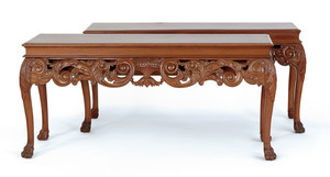 Pair of French carved mahogany consoles, the backs