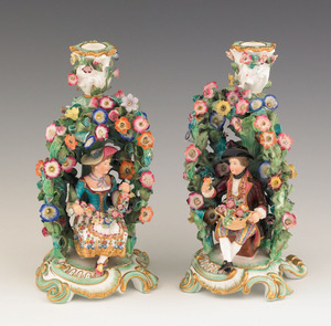 Pair of porcelain figural candlesticks, ca. 1900,/