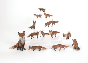 Thirteen Austrian cold painted bronze foxes, mid 2
