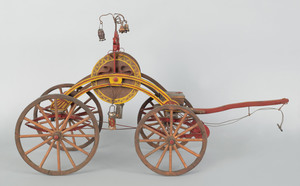 Painted wood model of a hand drawn hose reel carri
