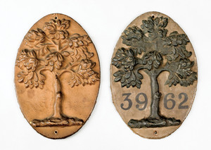 Two Mutual Assurance Company green tree cast ironi
