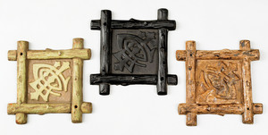 Three cast iron fire marks for the Lumbermen's Ins