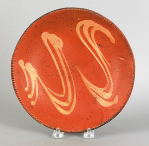 American redware pie plate, 19th c., with yellow s