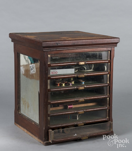 Spool cabinet, with seven glass front drawers