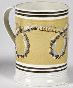 Mocha mug with earthworm decoration