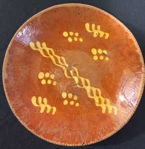 Four Pennsylvania redware chargers, 19th c.