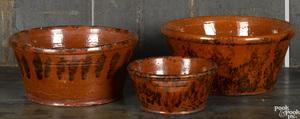 Three Pennsylvania redware mixing bowls, 19th c.