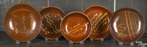 Five Pennsylvania redware plates, 19th c.