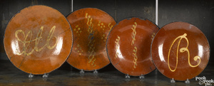 Four redware plates, 19th c.