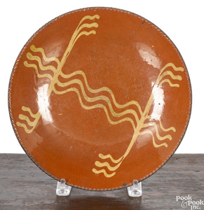 Pennsylvania redware plate, 19th c.