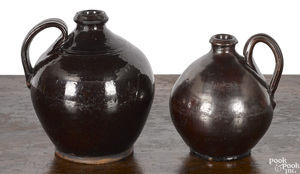 Two Pennsylvania ovoid redware jugs, 19th c.