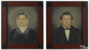 Pair of American oil on canvas folk portraits