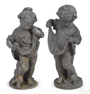 Pair of lead putti garden figures