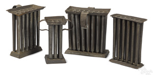 Four tin candlemolds, 19th c.