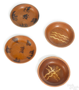 Four redware shallow bowls, 19th c.