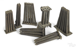 Seven tin candlemolds, 19th c.