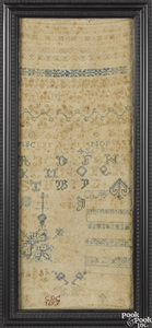 Silk on linen band sampler, dated 1693