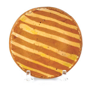 Miniature redware plate, 19th c., with yellow slip