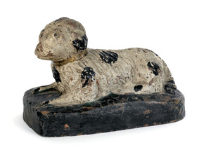Painted redware recumbent dog, 19th c., inscribed