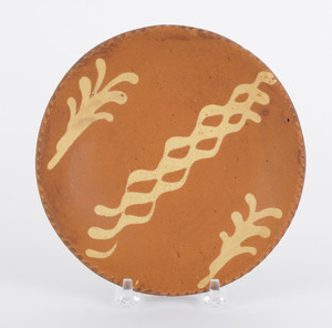 Pennsylvania redware plate, 19th c., with yellow s